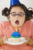 Young girl with birthday cupcake — Stock Photo