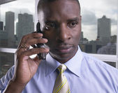 Close up of African businessman using cell phone — Stock Photo