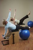 Two woman exercising on equipment — Stock Photo
