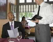 Man ordering in restaurant — Stock Photo