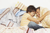 Young couple relaxing among blankets — Stock Photo