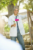 Man holding roses — Stock Photo