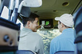 Men driving in golf cart — Stock Photo