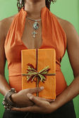 Midsection of woman with wrapped gift — Stock Photo