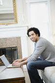 African man typing on laptop — Stock Photo
