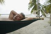 Sydamerikanska man sova i hängmatta — Stockfoto
