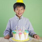 Portrait of Asian boy with birthday cake — Stock Photo
