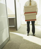 Businessman carrying boxes — Stock Photo