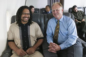 Portrait of men on airplane — Stock Photo