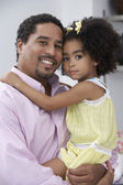 Father and daughter posing for the camera — Stock Photo
