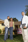 Portrait of couple with realtor at open house — Stock Photo