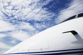 Nose of airplane under blue sky — Stock Photo