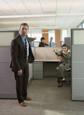Business pointing at each other in office cubicles — Stock Photo