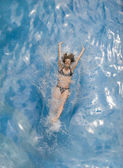 Woman splashing into water — Stock Photo