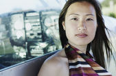 Portrait of woman leaning against airplane — Stock Photo