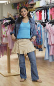 Hispanic teenaged girl shopping for clothing — 图库照片