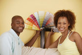Couple with color swatches — Stock Photo