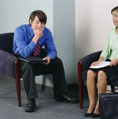 Businesspeople sitting in waiting room — Stock Photo