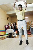 Man cheering at bowling alley — Stock Photo