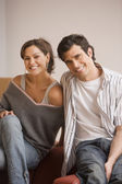 Young Hispanic couple smiling — Stock Photo