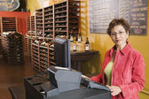 Portrait of woman selling wine — Stock Photo