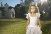 Young girl wearing a fairy costume in the backyard — Stock Photo
