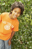 African boy smiling outdoors — Stock Photo