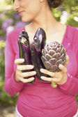 Woman holding vegetables — Stock Photo