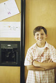 Young boy posing before refrigerator — Stock Photo