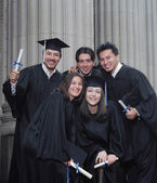 Graduates smiling for the camera — Stock Photo
