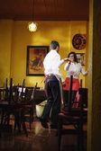 Wait staff dancing in empty restaurant — Stock Photo