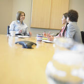 Businesswomen talking in conference room — Stock Photo