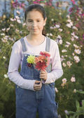 Pacific Islander girl holding wildflowers — Stock Photo
