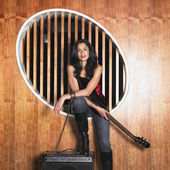 Hispanic woman holding electric guitar — Stock Photo