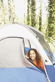 African American girl peeking out of tent — Stock Photo