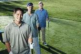 Golfers posing together — Stock Photo