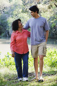 Hispanic mother and adult son walking outdoors — Stock Photo