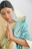 Indian woman in traditional clothing praying — Stock Photo
