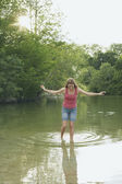 Young woman walks in the lake — Stock Photo