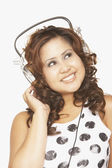 Asian woman listening to headphones — Stock Photo