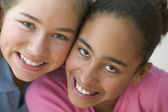 Close up portrait of two girls smiling — Stock Photo