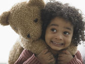 Young boy holding teddy bear — Stock Photo