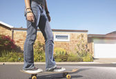 Teenage girl standing on skateboard — Stock Photo