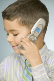Close up of young boy talking on mobile phone — Stock Photo