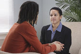 Businesspeople talking in office — Stock Photo
