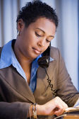 African businesswoman checking watch — Stock Photo