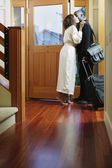 Couple kissing at door — Stock Photo