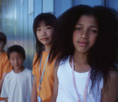 Group portrait of children standing against wall — Stock Photo
