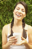 Portrait of woman holding mug in hands — Stock Photo