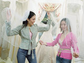 Young women wearing veils in a bridal boutique — Stok fotoğraf